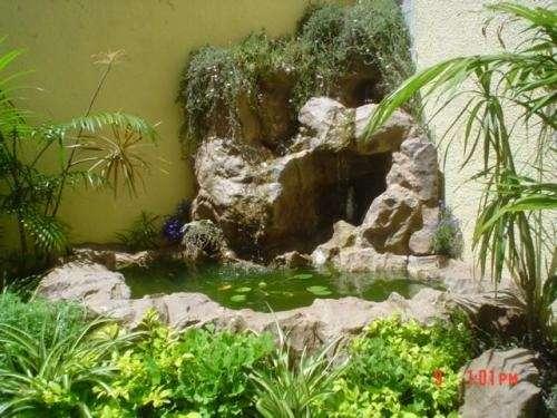 Fotos de jardines de agua santa fe casa jardin for Cascadas para jardines casas