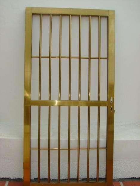 Imagenes trabajos en metal y en hierro puertas ventanas for Rejas y portones