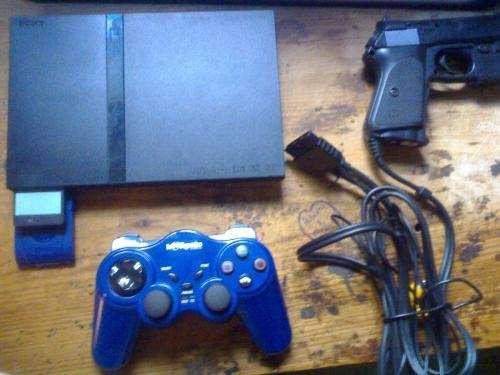 Vendo playstation 2+joystick inalambrico+pistola laser+50 juegos