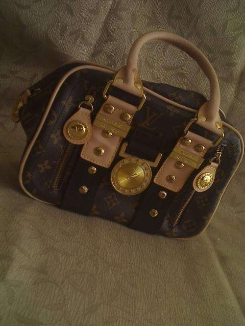 Vendo cartera louis vuitton