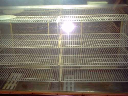 Vendo heladera exhibidora vidrio recto de acero inoxidable