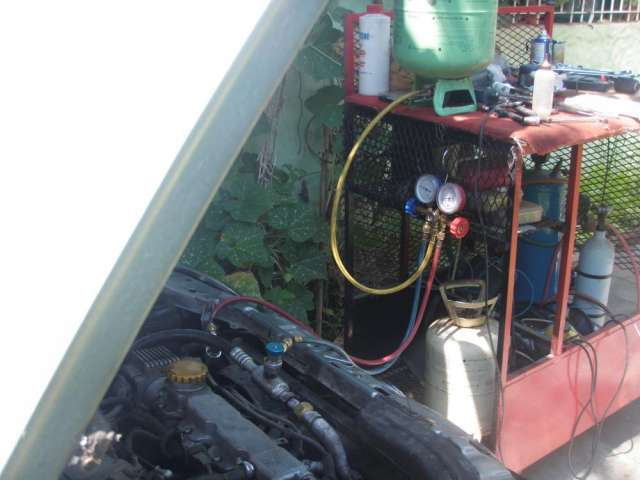 Carga de aire acondicionado automotor