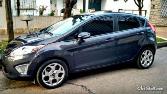 Estoy ofreciendo ford fiesta kinectic titanium 2013 el precio mas bajo.
