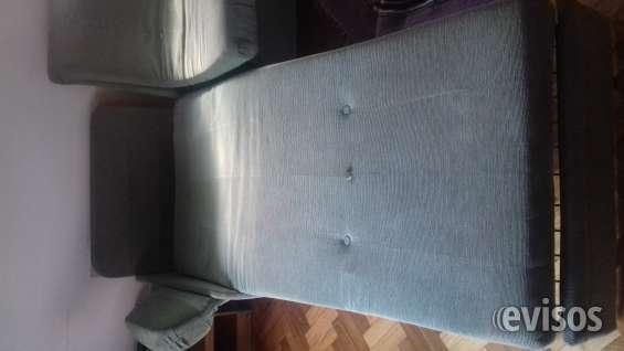 Transformado en una cama de una plaza y un sillón