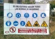 Cartelería de seguridad en Av. Lamadrid en Bernal
