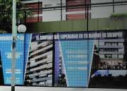 Cartel de obra en construcción en Monte Grande