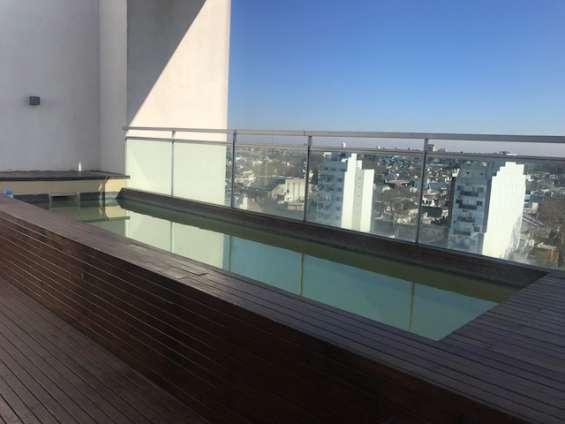 Fotos de Piso alto al contrafrente. impecable monoambiente. edificio piscina 10